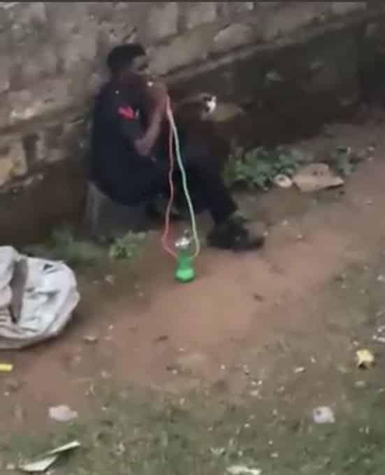 Watch Video Of Nigerian Policeman Smoking Shisha While On Duty