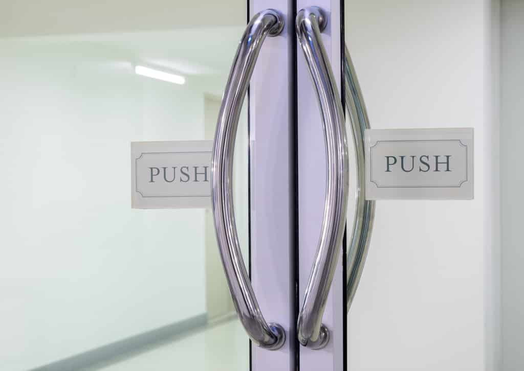 Double doors with push sign