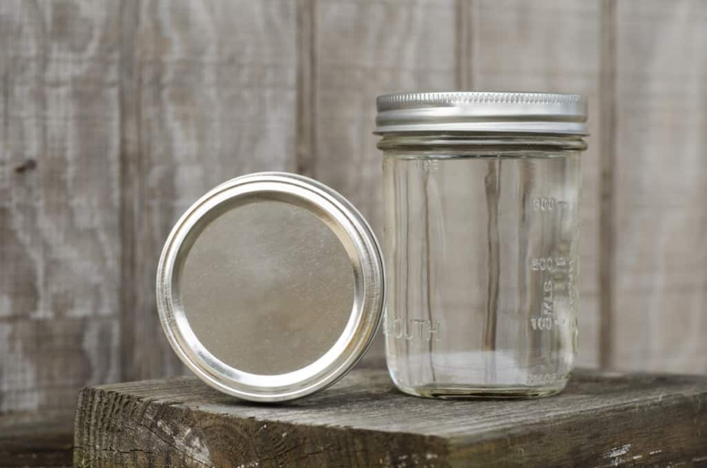 Empty mason jar on block of wood
