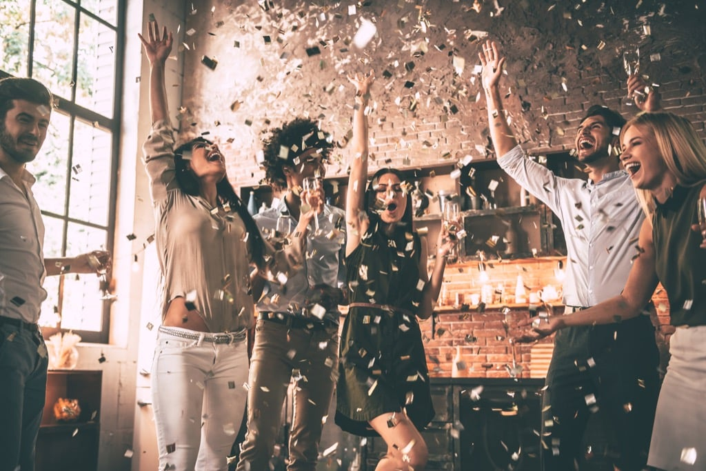 Friends having party with confetti