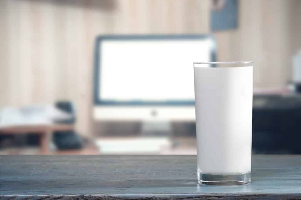 Glass of milk on table