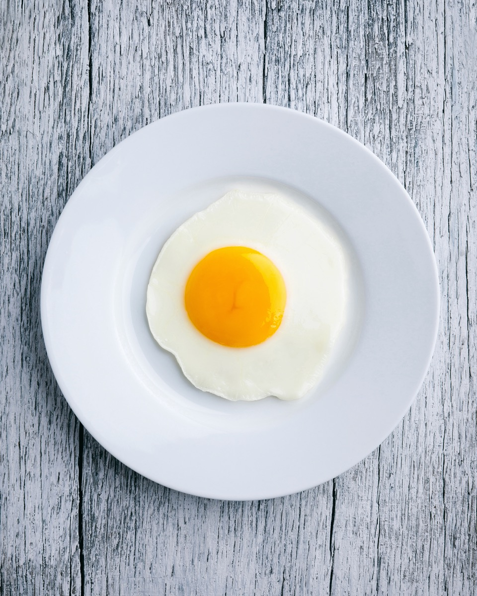 Fried egg on white plate